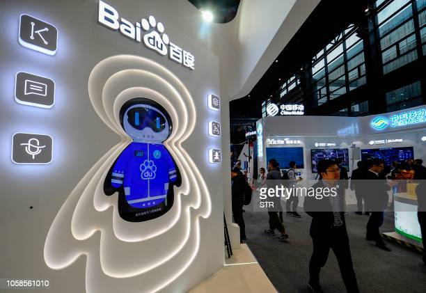 This photo taken on November 6, 2018 shows a man walking past a booth of Baidu at the Light of Internet Expo ahead of the 5th World Internet...