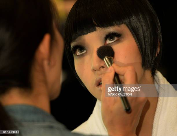 This photo taken on November 7 2013 shows Chinese models preparing backstage before filming the lingerie section of the China's Next Top Model TV...