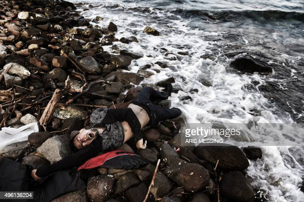 This photo taken on November 7 2015 shows the body of a man washed ashore on the Greek island of Lesbos Nearly 500 people have died trying to cross...