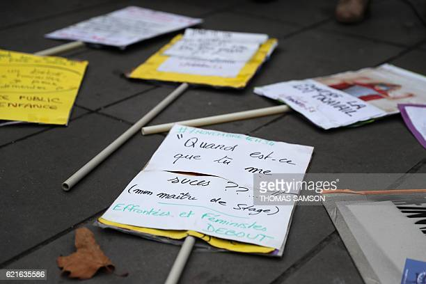 This photo taken on November 7 2016 at Place de la Republique in Paris shows signs and placards on the ground during a demonstration for equal pay...