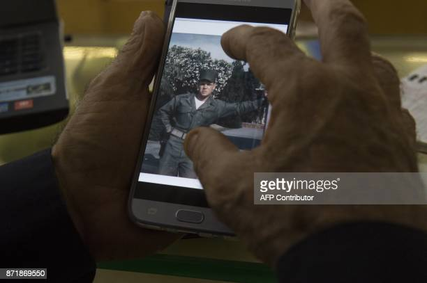 This photo taken on November 7 2017 shows David E Clark a former US Marine and critic of US President Donald Trump looking through old photographs...
