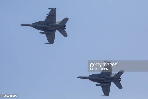 This photo taken on November 7 2018 shows Australian RAAF F/A18 Super Hornet fighters passing over APEC Haus in Port Moresby the host city for the...