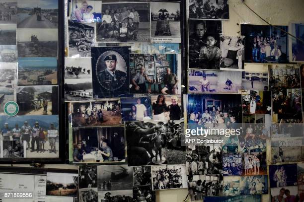 This photo taken on November 8 2017 shows a collection of photographs from the Vietnam Warera left by US soldiers at Tam's Pub a popular hangout for...