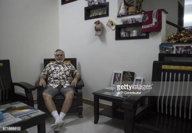 This photo taken on November 8 2017 shows Chas Lehmann a former US Marine and supporter of US President Donald Trump sitting inside his home in...