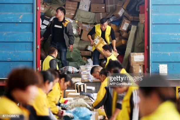 This photo taken on November 9 2017 shows employees sorting packages ahead of Singles Day in Huaibei in China's eastern Anhui province Singles Day is...