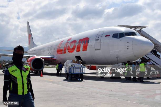 This photo taken on October 10 2018 shows a Lion Air Boeing 737800 aircraft at the Mutiara Sis Al Jufri airport in Palu An Indonesian Lion Air...