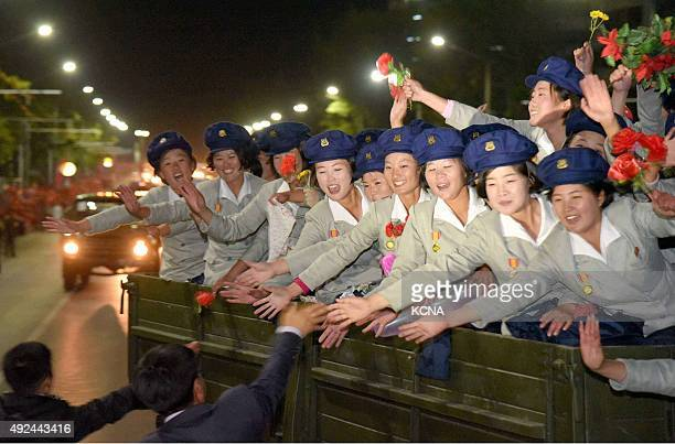 This photo taken on October 10 and released on October 11 by North Korea's official Korean Central News Agency shows North Korean women soldiers...