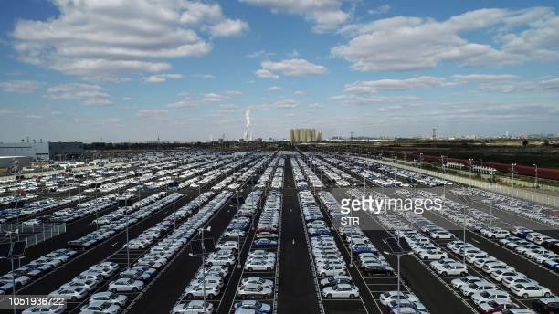 This photo taken on October 11 2018 shows new BMW cars lined up at a BMW factory in Shenyang in China's northeastern Liaoning province German luxury...
