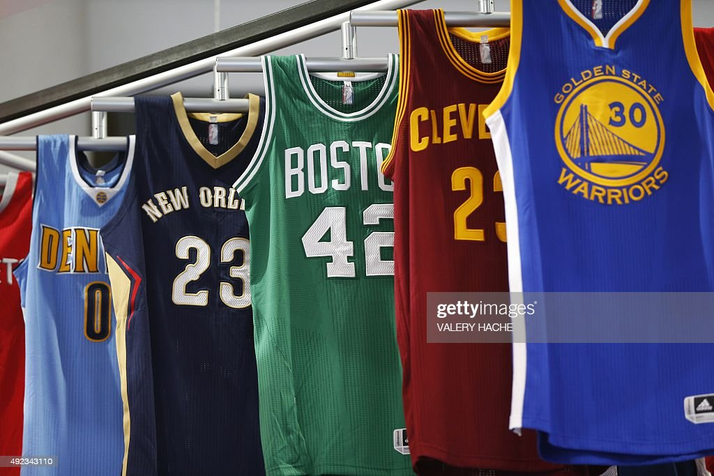 This photo taken on October 12, 2015 shows National Basketball Association (NBA) jerseys on display at the The World Sports Content Media Convention (Sportel) in Monaco. Sportel, an international business platform, is part of the Monegasque Association, Monaco Mediax, which is under the Honorary Presidency of Prince Albert II of Monaco.