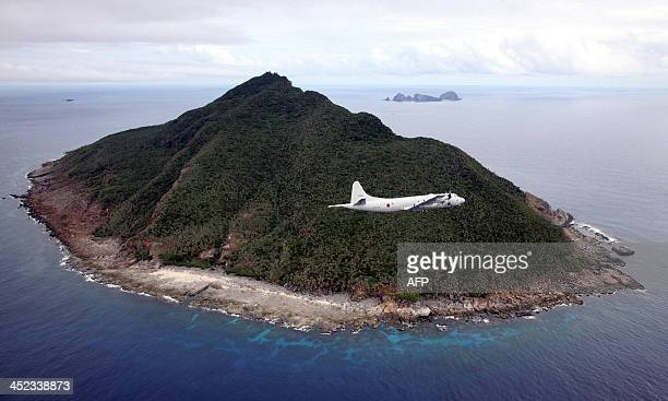 This photo taken on October 13, 2011 shows a P-3C patrol plane of Japanese Maritime Self-Defense Force flying over the disputed islets known as the...