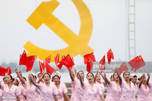 This photo taken on October 13, 2017 shows people performing to welcome the upcoming 19th Party Congress in Huaibei in China's eastern Anhui...