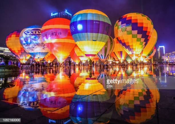 TOPSHOT This photo taken on October 14 2018 shows hot air balloons displayed on a square during the 2018 Outdoor Sports Conference in Xingyi in...