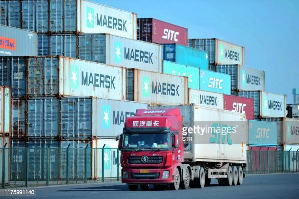 This photo taken on October 14, 2019 shows containers stacked at the port in Qingdao, in China's eastern Shandong province. - China's imports and...