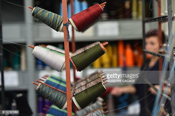 This photo taken on October 18, 2016 shows spools of thread at the Missoni factory in Sumirago, near Varese. / AFP / GIUSEPPE CACACE