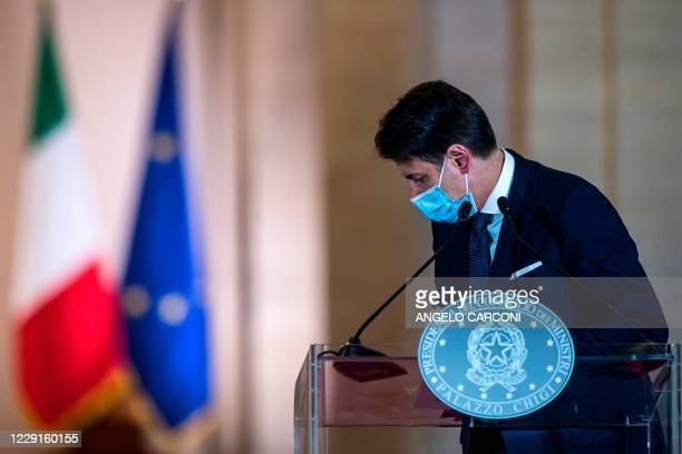This photo taken on October 18 and provided by Italian news agency ANSA shows Italian Prime Minister Giuseppe Conte giving a press conference to...