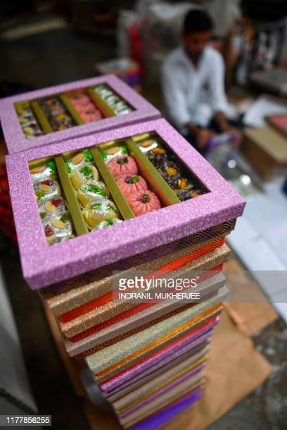 This photo taken on October 18 shows a stack of gift boxes of sweets at a factory in Mumbai ahead of the Hindu festival Diwali As Asia's thirdlargest...