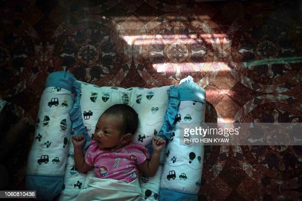 This photo taken on October 19 2018 shows a baby of an unmarried woman resting at the Myint Mo Myittar Single Mothers' Foundation in Yangon Myanmar...