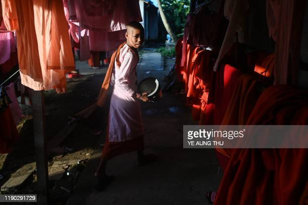 This photo taken on October 19 2019 shows a Buddhist nuns walking to collect alms in the Mingalar Thaikti nunnery in Yangon All of the Mingalar...