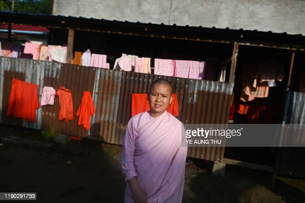 This photo taken on October 19 2019 shows Buddhist nun Dhama Theingi posing for a photo at the Mingalar Thaikti nunnery in Yangon All of the Mingalar...