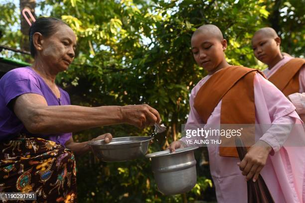 This photo taken on October 19 2019 shows Buddhist nuns from the Mingalar Thaikti nunnery collecting alms in Yangon All of the Mingalar Thaikti...