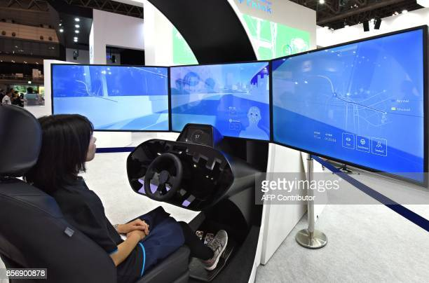 This photo taken on October 2 2017 shows a cockpit demonstration of Omron's driver monitoring sensor to illustrate the future of autonomous driving...