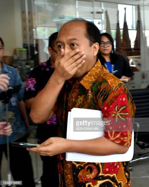 This photo taken on October 2 2018 shows Indonesia's disaster agency spokesman Sutopo Purwo Nugroho arriving for a press conference in Jakarta to...