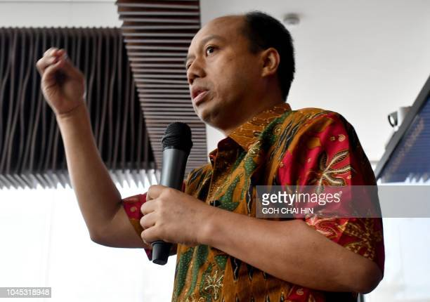 This photo taken on October 2 2018 shows Indonesia's disaster agency spokesman Sutopo Purwo Nugroho addressing the media during a press conference in...