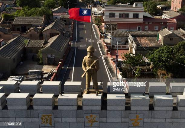 This photo taken on October 20, 2020 shows a military statue and Taiwanese flag on top of an arch built in remembrance of the Battle of Guningtou in...