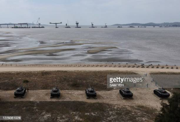 This photo taken on October 20, 2020 shows an aerial view of anti-landing spikes and retired tanks placed along the coast of Taiwan's Kinmen islands,...