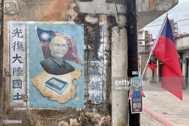 This photo taken on October 21, 2020 shows a painting of Taiwan's former president Chiang Kai-shek, who died in 1975, on the wall of a building on...