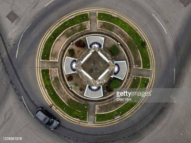 This photo taken on October 21, 2020 shows an aerial view as a car drives past a monument to remember the 823 Artillery Battle in 1958 on Taiwan's...