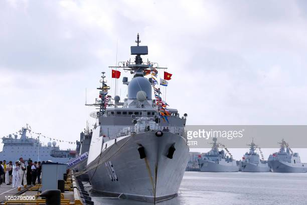 This photo taken on October 22 2018 shows a Vietnamese navy ship near Chinese navy ships at a military port in Zhanjiang in China's southern...