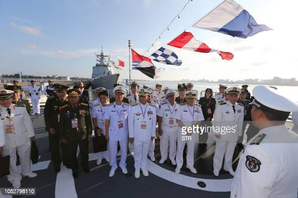 This photo taken on October 22 2018 shows Chinese and Association of Southeast Asian Nations navy representatives attending the opening ceremony of...
