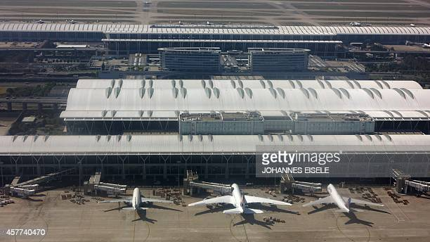This photo taken on October 23 2014 in Shanghai shows planes parking at Terminal 2 of the Shanghai Pudong International Airport AFP PHOTO / JOHANNES...