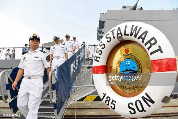 This photo taken on October 24 2018 shows Chinese sailors visiting Singapore Navy's frigate RSS Stalwart during the ASEANChina Maritime Exercise at a...