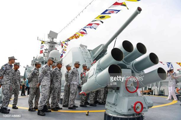 This photo taken on October 24 2018 shows Thai sailors visiting Chinese guided missile destroyer Guangzhou during the ASEANChina Maritime Exercise at...