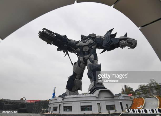 This photo taken on October 26 2017 shows a 53meter high replica of a transformer at a construction site of East Valley of Science and Fantasy...