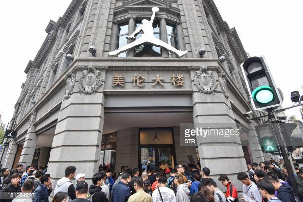 This photo taken on October 26 2019 shows people waiting outside a Nike store to buy the newlyreleased Nike sneaker in Shanghai Enthusiasts worldwide...