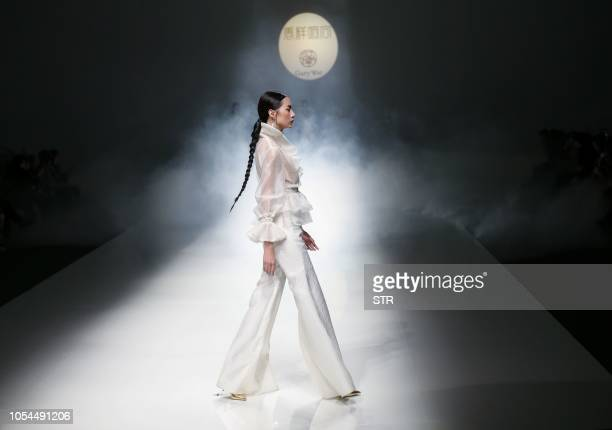 TOPSHOT This photo taken on October 27 2018 shows a model parading a creation from the Gambiered Caton Gauze collection by Qu Tingnan during China...