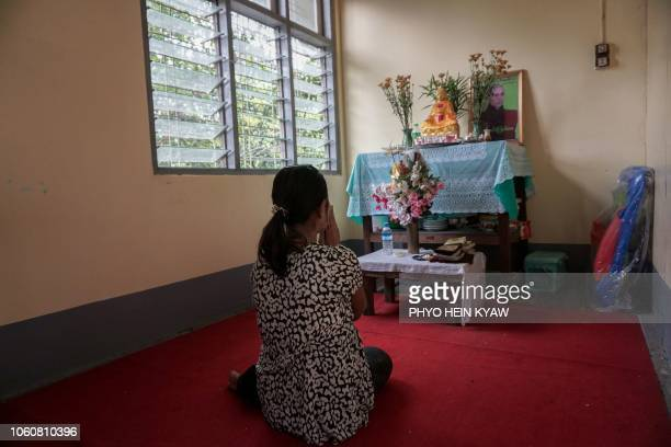 This photo taken on October 3 2018 shows Aye Mar eight months pregnant and unmarried praying as she takes refuge at the Myint Mo Myittar Single...