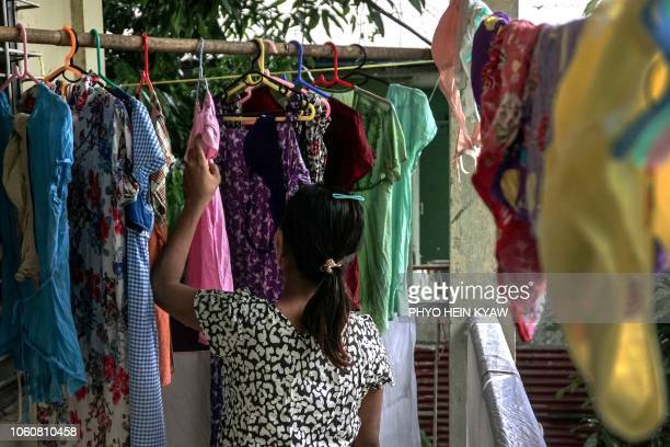 This photo taken on October 3 2018 shows Aye Mar eight months pregnant and unmarried drying laundry while taking refuge at the Myint Mo Myittar...