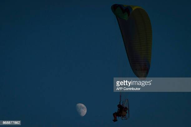 This photo taken on October 30 2017 shows a parachutist practicing for the upcoming 2017 FAI World Flyin Expo at Hannan airport in Wuhan in China's...