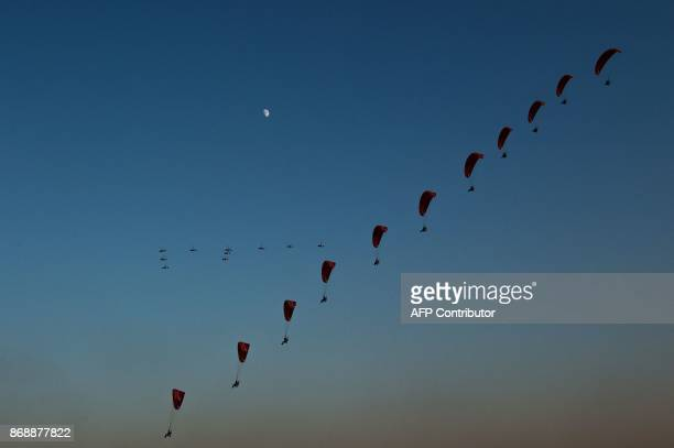 This photo taken on October 30 2017 shows powered parachutists practicing for the upcoming 2017 FAI World Flyin Expo at Hannan airport in Wuhan in...