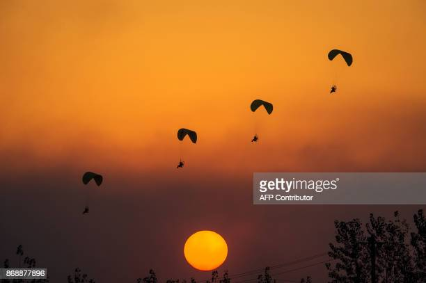 TOPSHOT This photo taken on October 30 2017 shows powered parachutists practicing for the upcoming 2017 FAI World Flyin Expo at Hannan airport in...