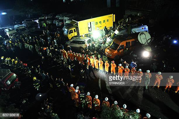 This photo taken on October 31 2016 shows rescuers and firefighters waiting in line at Jinshangou Coal Mine in Yongchuan District of Chongqing All 33...
