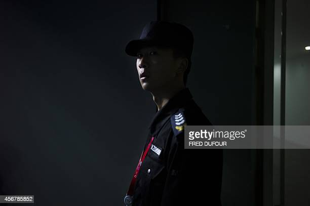 This photo taken on October 4 2014 shows a security guard standing at the National Tennis Center of Beijing The IMF's analysis and projections of...