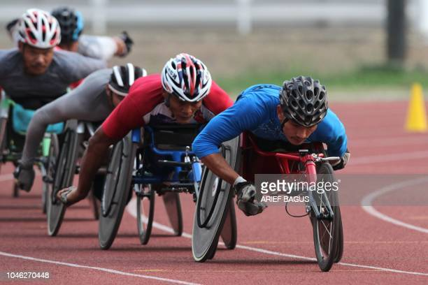 This photo taken on October 5 2018 shows athletes training for the men's wheelchair race ahead of the 2018 Asian Para Games in Jakarta
