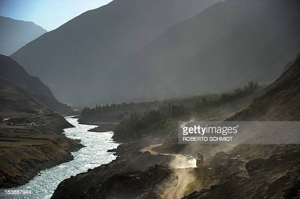 This photo taken on October 6 2012 shows a man walking on the main road leading east from Faizabad the capital of the province of Badakhshan The road...