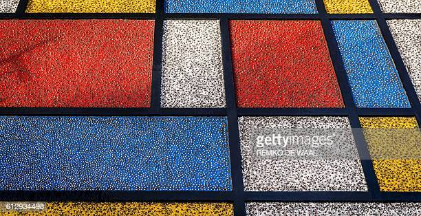 This photo taken on October 6 2016 in Lisse shows bulbs planted in the form of a mosaic inspired by the painter Piet Mondrian following the theme of...