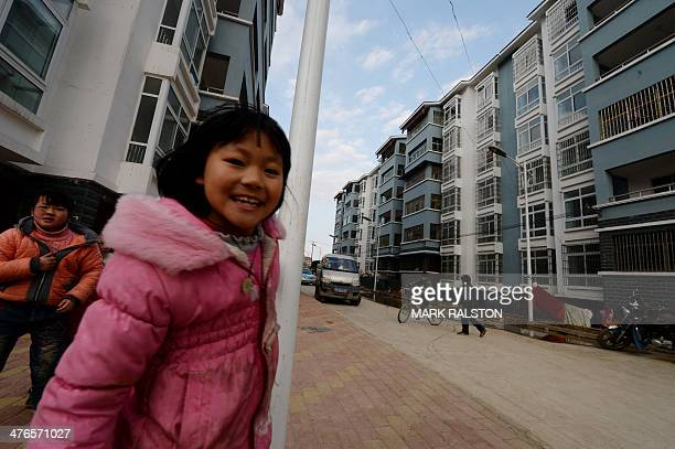 This photo taken on on February 20 2014 shows former rural residents in their new highrise apartments near the city of Anshun Guizhou Province Since...